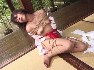 Chinese confined in wire restrain bondage outdoors by dom